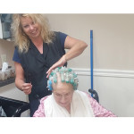 Resident getting her hair done in the salon