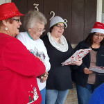 Women caroling to the community