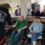 Veterans being honored by a visiting veteran