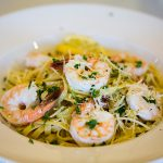 Shrimp fettuccini with parmesan and basil sprinkled over the top