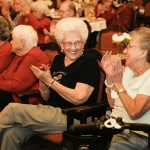 A group of residents laughing and clapping together