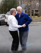 Eagleview couple dancing in the street