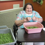 Colonial Haven resident preparing green beans