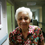 Eagleview resident in the hallway smiling