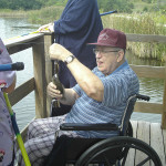 Farmington Country Manor residents fishing in a lake