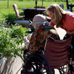 Farmington resident and staff member looking at the garden together