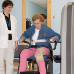 Farmington residents working with rehab staff on exercise equipment