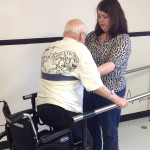 Oak Trace rehab staff assisting a resident with walking