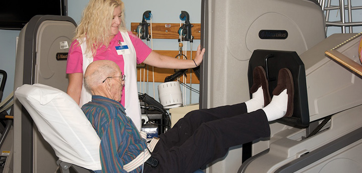 Farmington therapy staff working with a resident in outpatient therapy