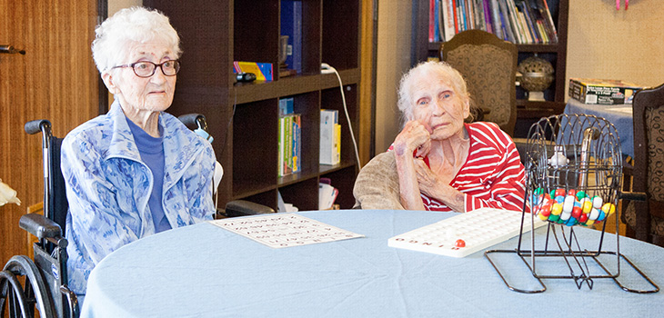 Two residents playing Bingo together