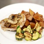 Pork Chop and potatoes with zucchini