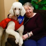 Resident with a therapy dog