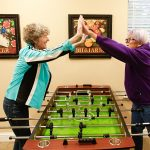 Two residents playing a table game together