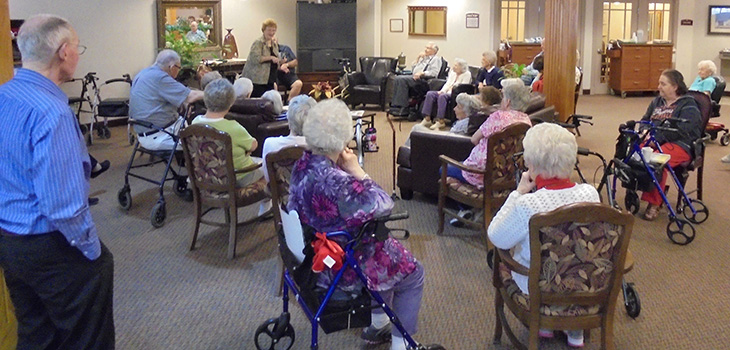 residents gathered to watch a lively performance