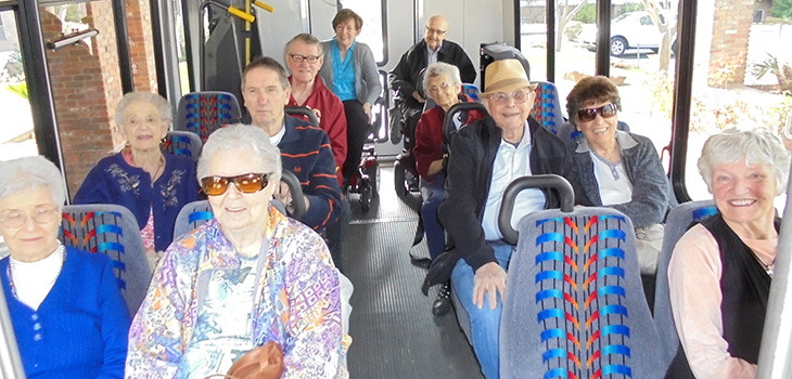 Residents on the travel van ready to take a trip