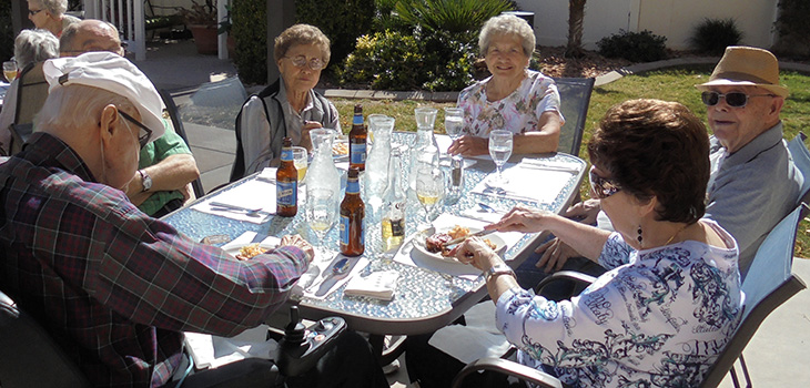 residents outside enjoying beers on the patio together