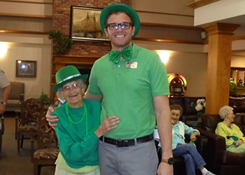 staff & resident dressed for St. Paddy's Day