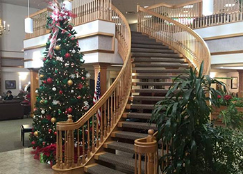 sweeping staircase in main lobby decorated for the holidays