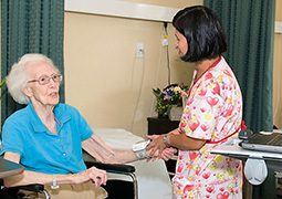nurse aiding resident