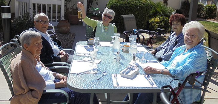 Residents toasting to a beautiful day and enjoying the outdoors