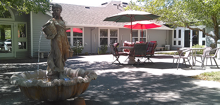 Fountain and shaded outdoor seating area