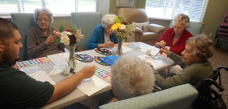 residents painting with watercolors