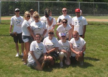 Staff members dressed up playing a baseball game