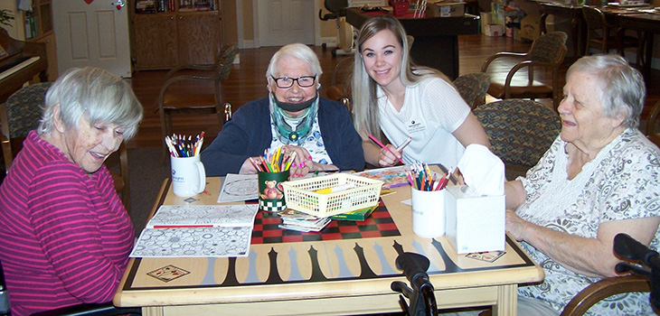 residents having fun using coloring books