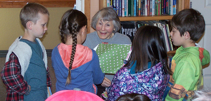children reading stories to residents