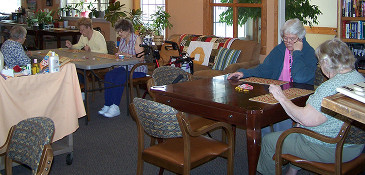 residents playing games in the recreation room