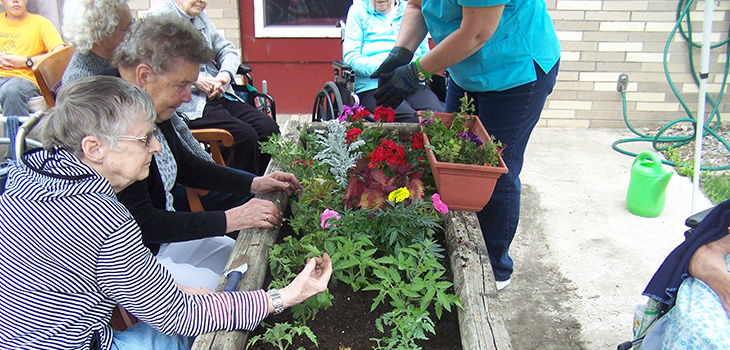 residents gardening together at the facility