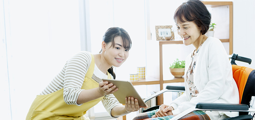 Two ladies looking at a lap top together.