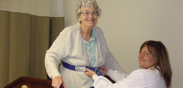 Nurse helping resident with physical therapy