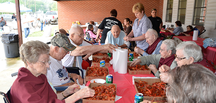 Residents having a shellfish feast outside and shelling the food themselves