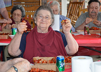 Residents having a shellfish feast and shelling the food themselves