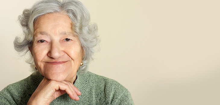 elderly woman wearing a green sweater
