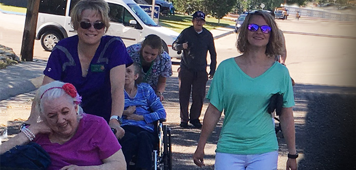 Residents, staff and loved ones going for a walk