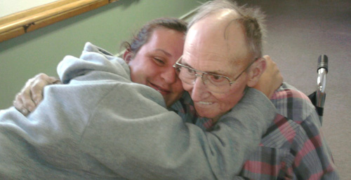 Resident and loved one hugging
