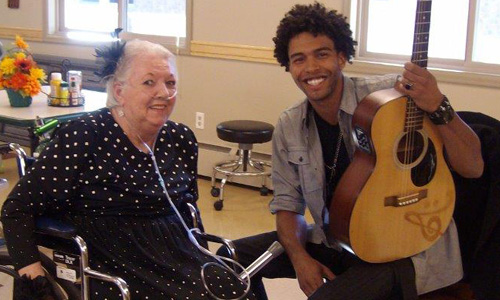 Resident and a musician smiling