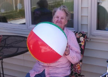 A resident holding a beach ball outside