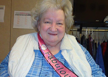 A resident wearing a sash that says 'Fabulous'