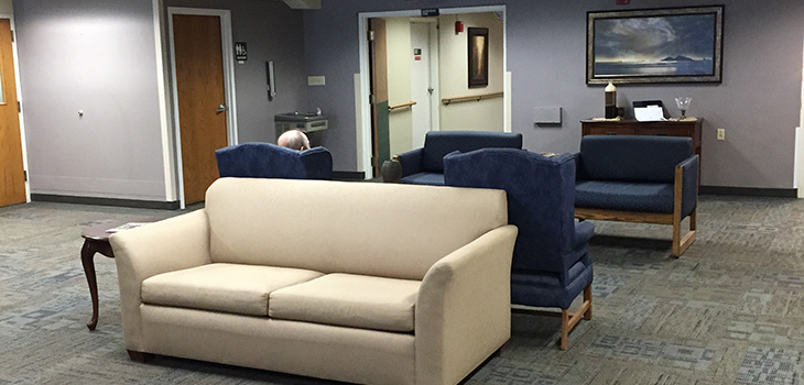Several couches indoors for residents to lounge on.