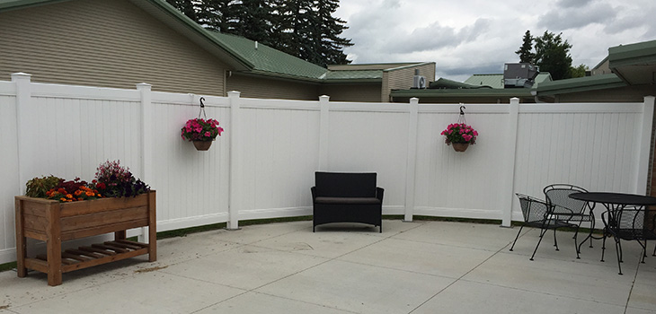 Fenced in outside patio with several options for seating.