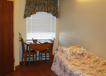 parkside facility bedroom with a dining table