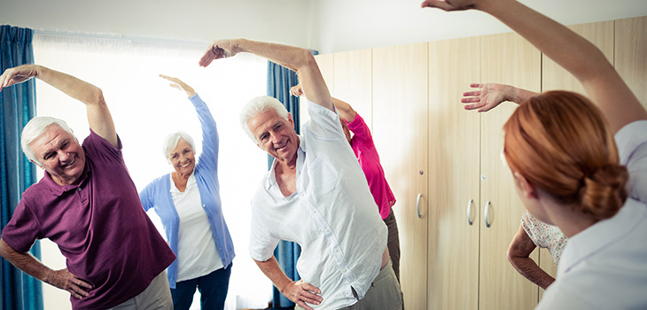 Seniors in a group doing exercises together.