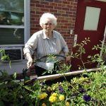 resident gardening outside the facility