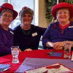 residents sitting together eating snacks at the christmas party together