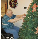 resdient decorating the christmas tree