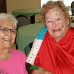 residents smiling together at the facility