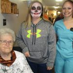 residents smiling together on halloween with face paint on